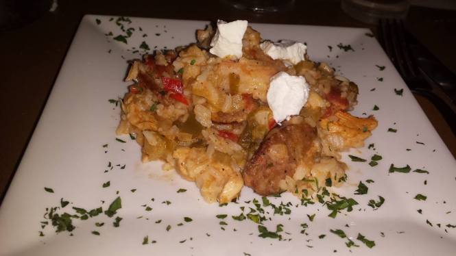 Masq's Jambalaya consists of Cajun Spiced Chicken, Andouille Sausage, Shrimp, and Goat Cheese. Make sure to mix the goat cheese!