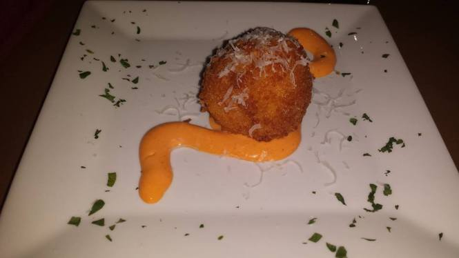 Mac 'N' Cheese Croquette with Bacon, Cheddar, and Jalapeño. Served with Spicy Remoulade Sauce