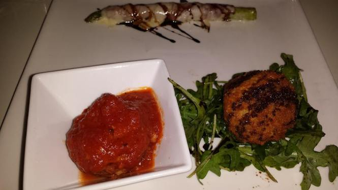 Crochette di Ricotto e Tonno (Tuna and Ricotta Cheese Croquettes) on the right, Polpette al Pomodoro (Grass-Fed Beef Meatball in Tomato Sauce) on the left, and Asparagi Gratinate  (Asparagus Wrapped in Speck and Fontina Cheese) at the top