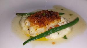Sole Fish with bread crumbs, white wine, and lemon on a bed of mashed potatoes