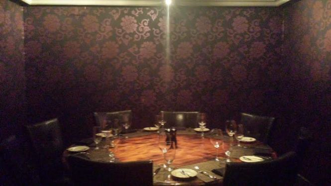 With elegant wallpaper and a custom table, the Leather Room is my favorite!